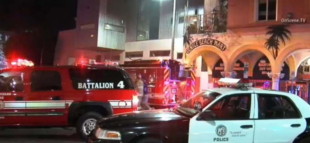 Police say officers responding to a 911 call found a man in his 20s arguing with a bouncer outside a bar and that the officers opened fire when an altercation ensued.