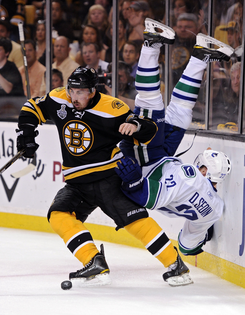 Brad Marchand, #63, of the Boston Bruins hits Daniel Sedin, #22, of the Vancouver Canucks during Game Four of the 2011 NHL Stanley Cup Final.
