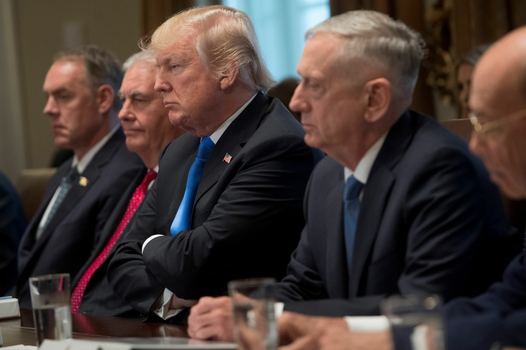 President Donald Trump holds a Cabinet meeting alongside Secretary of the Interior Ryan Zinke (L), Secretary of State Rex Tillerson (2nd L), Secretary of Defense Jim Mattis (2nd R) and Secretary of Commerce Wilbur Ross (R) on Dec. 20, 2017.