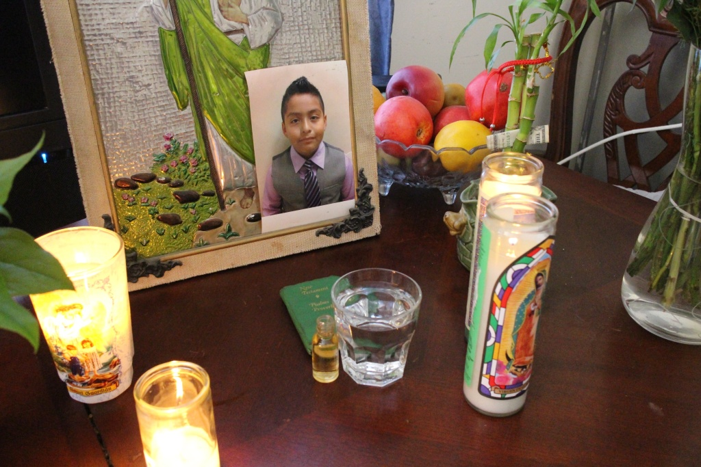 Candles and a picture of Jesse Romero, who was shot by police on Aug. 9. The LAPD says a witness saw Romero, a gang member, fire a gun at officers as they chased him.