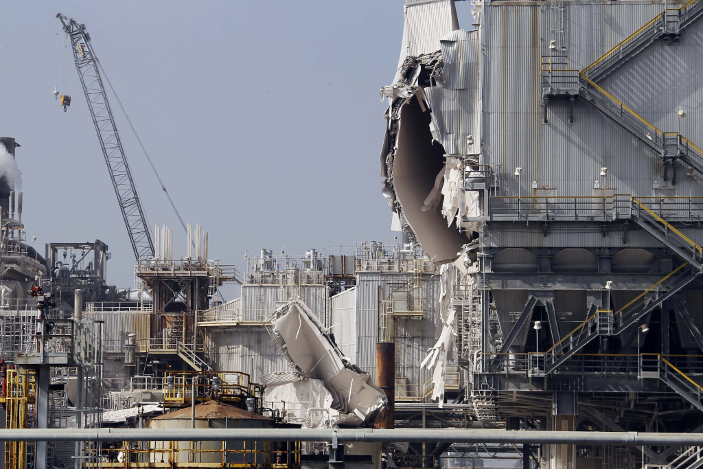 The ExxonMobil refinery is seen after an explosion in a gasoline processing unit at the facility, in Torrance, Calif., on Wednesday, Feb. 18, 2015. Two workers suffered minor injuries and a small fire at the unit was quickly put out. The incident triggered a safety flare to burn off flammable substances. The facility about 20 miles south of downtown Los Angeles covers 750 acres, employs over a thousand people, and processes an average of 155,000 barrels of crude oil per day, according to the company. (AP Photo/Nick Ut)