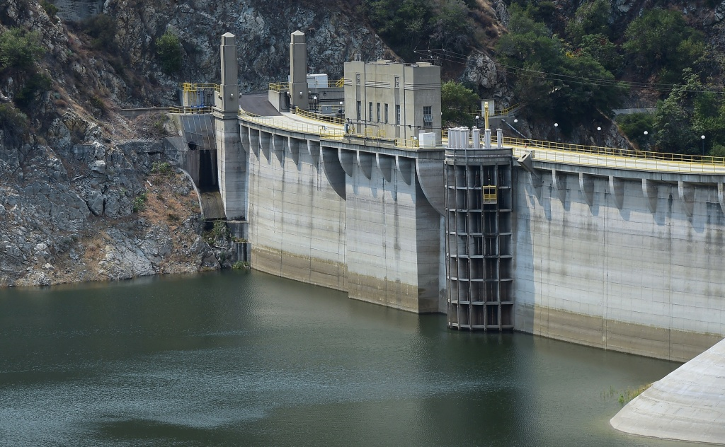 A lowering water level can be seen at Morris Dam, which holds back the San Gabriel River in the San Gabriel Mountains, north of Azusa and east of Los Angeles on July 29, 2014 in California, where emergency water-conservation measures are being implemented as the state struggles through its third year of drought amid lowering water supplies in its reservoirs, parched dry land on farms across the state and a heightened concern for wildfire dangers. New restrictions carrying a $500 penalty come into effect in California on August 1st regarding outdoor water use.