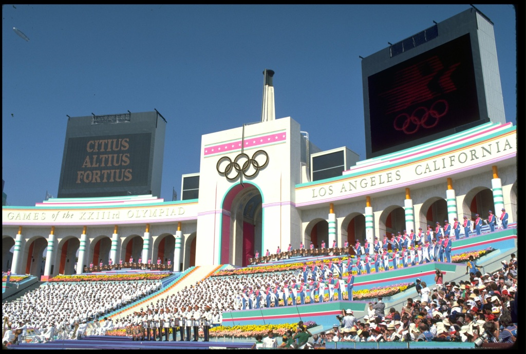 The Olympic motto of Citius, Altius and Fortius is displayed on a giant television screen at the opening ceremony of the 1984 summer Olympics. The ceremony took place in the Coliseum in Los Angeles, California.