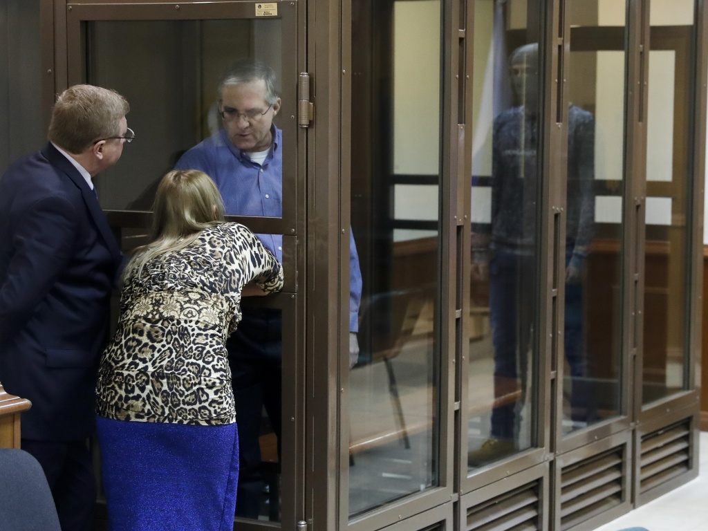 Paul Whelan, a former U.S. Marine arrested in Moscow at the end of last year, looks through a cage's glass as he speaks to his lawyers in a court room in Moscow, Russia, at a January hearing.