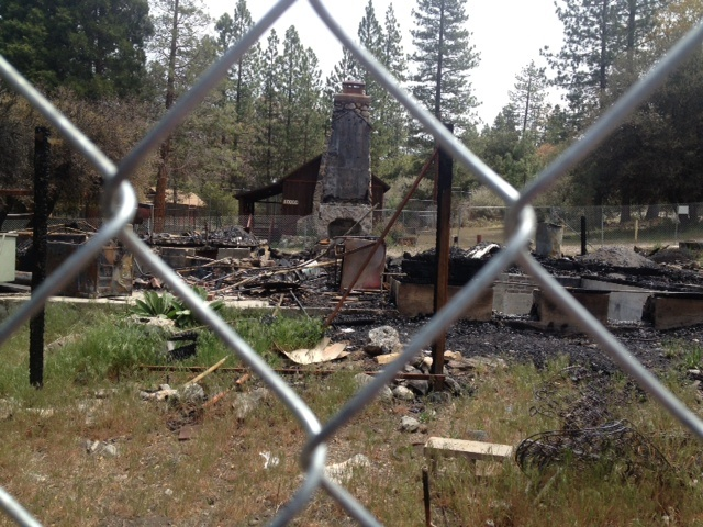 The stone chimney of the cabin where Christopher Dorner died near Big Bear is about the only thing left standing after the fire burnt the buiulding down to its foundation.