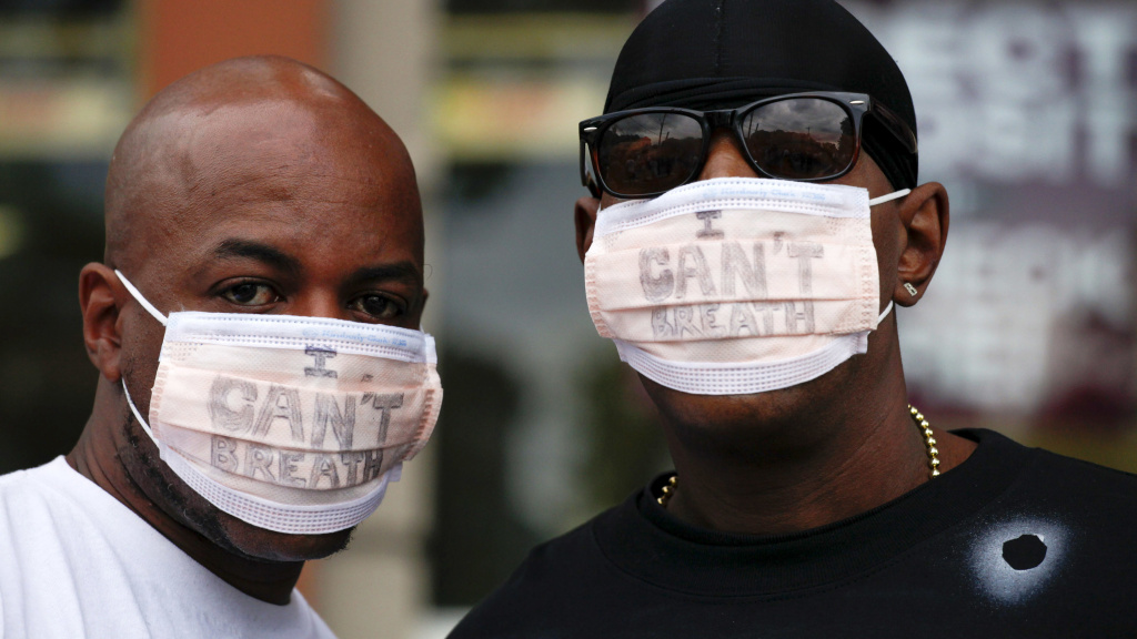 New York City police are giving the Justice Department a deadline to announce criminal charges in the 2014 death of Eric Garner. Garner's death spurred protests, including by two men who wore medical masks reading