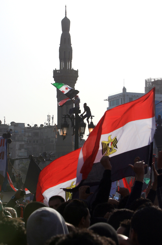 Egyptian wave their national flag as tens of thousands gather for a mass rally in Cairo's Tahrir Square on January 25, 2012, marking the first anniversary of the uprising that toppled president Hosni Mubarak as a debate raged over whether the rally was a celebration or a second push for change.