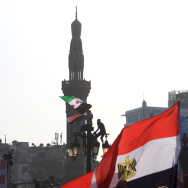 Egyptian wave their national flag as ten