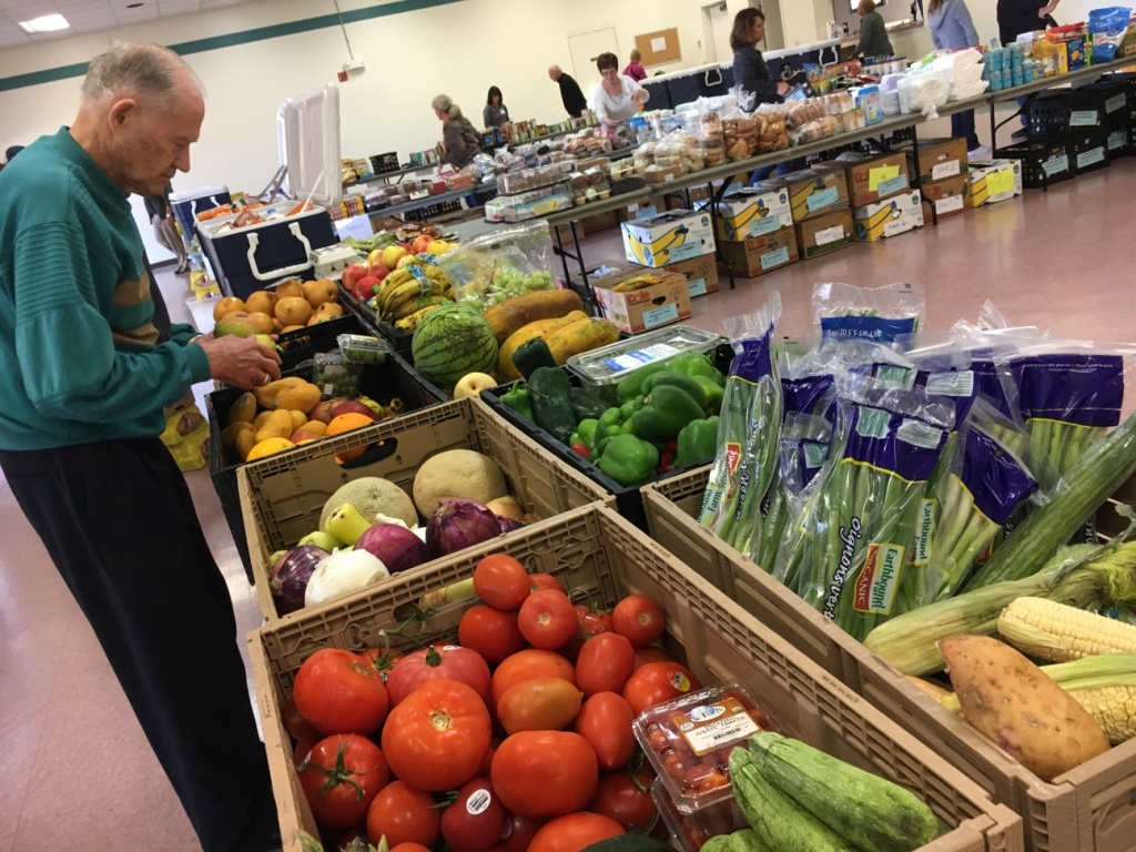 A volunteer with the Saddleback Church prepares produce at the group's food pantry on the Camp Pendleton Marine Base near San Diego. The pantry typically serves about 100 active duty military families each month.