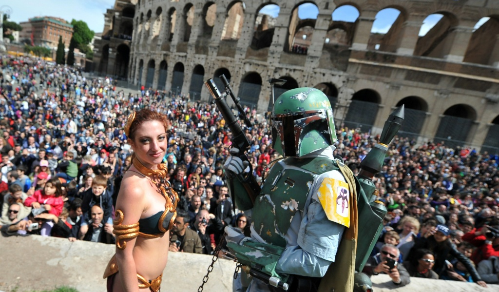 Members of a Star Wars fan club dressed as Princess Leia (left) and bounty hunter Boba Fett (right) celebrate