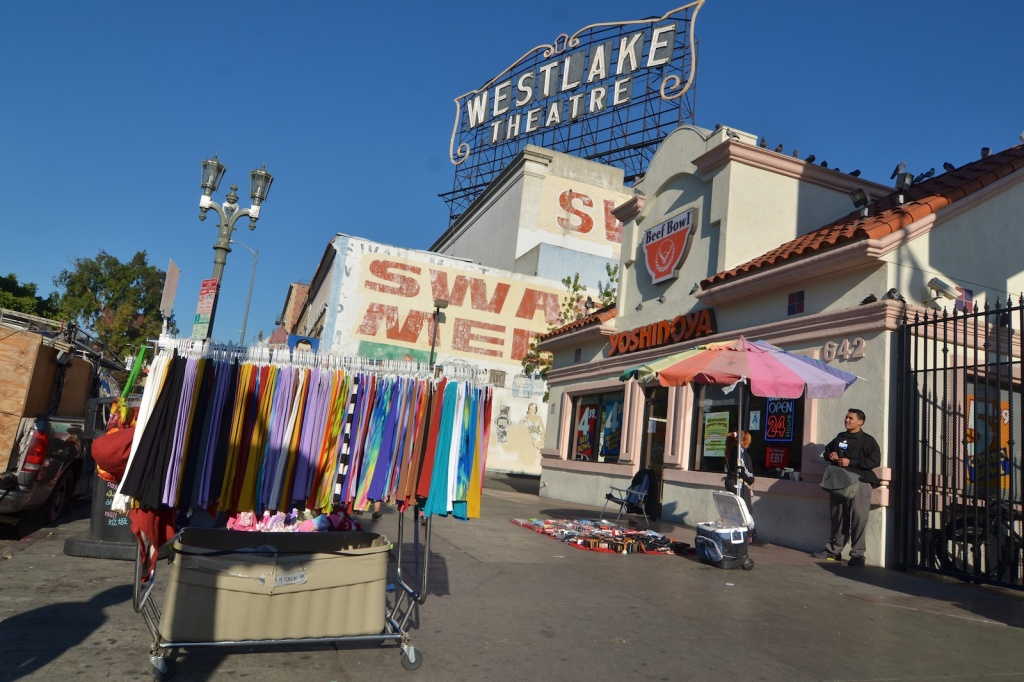 Vendors selling clothes, electronics and more on Alvarado Street across from MacArthur Park.