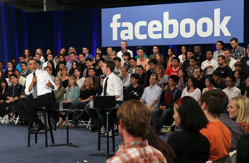 U.S. President Barack Obama (L) talks with Facebook CEO Mark Zuckerberg (R) during a town hall style meeting at Facebook headquarters in Palo Alto, California.