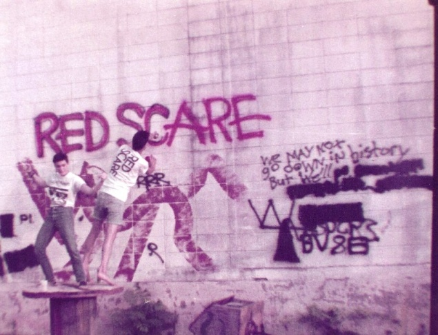 3 Bobbi and Rudy Matchinga tagging a wall in Houston, Texas while on tour in 1984.