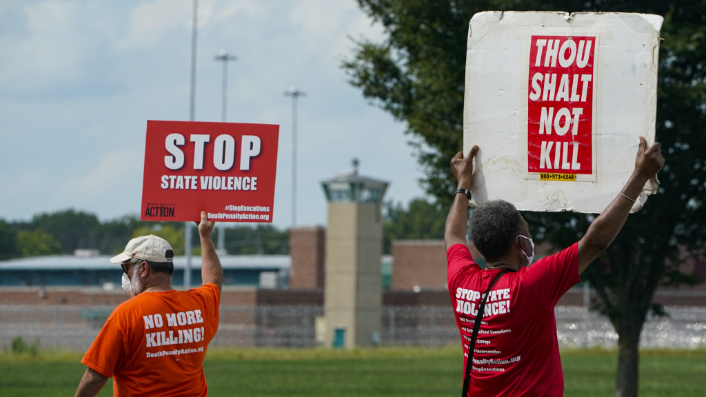 Protesters gather near the federal prison complex in Terre Haute, Ind., in August ahead of the scheduled execution of Keith Dwayne Nelson, who was convicted of kidnapping, raping and murdering at 10-year-old Kansas girl. Democrats are pushing new legislation to outlaw federal executions.