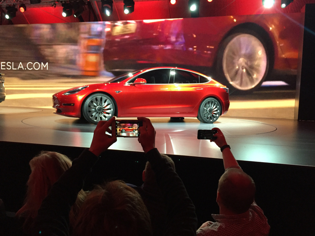 Tesla Motors unveiled the new lower-priced Model 3 sedan at the Tesla Motors design studio Thursday, March 31, 2016, in Hawthorne, California. It doesn't go on sale until late 2017, but in the first 24 hours that order banks were open, Tesla said it had more than 115,000 reservations.