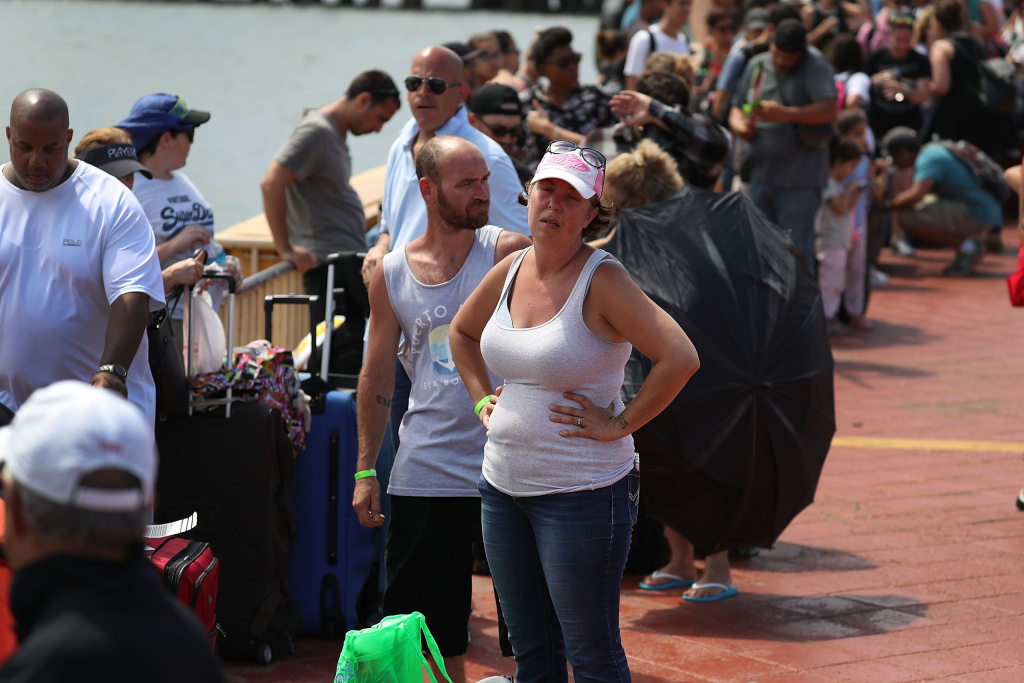Gary Flores and Tabatha Flores stand in line with other people to get on a Royal Caribbean relief boat sailing to Ft. Lauderdale, Florida after Hurricane Maria.