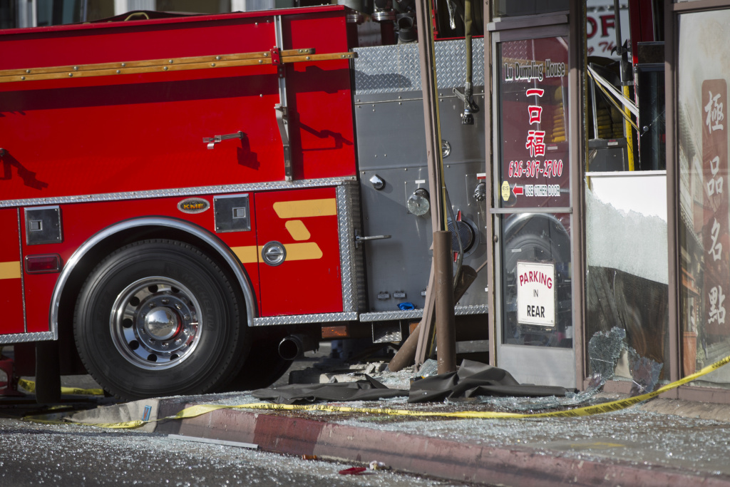 Two fire trucks collided, sending one into Lu's Dumpling House at Garfield and Emerson Avenues in Monterey Park on Wednesday afternoon, April 16, 2014.