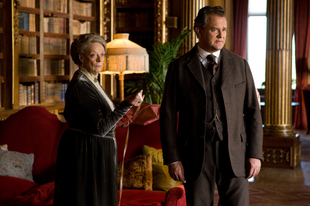 File: In this image released by PBS, Maggie Smith as the Dowager Countess, left, and Hugh Boneville as Lord Grantham are shown in a scene from the second season on