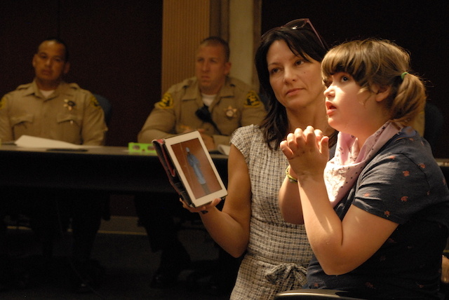 Bobbie Hendrickson brought her 14-year-old daughter Sydney to a Los Angeles County Sheriff's Department seminar on interactions with the autistic. Sydney, who is autistic, sometimes relies on her computer tablet to communicate with her family.