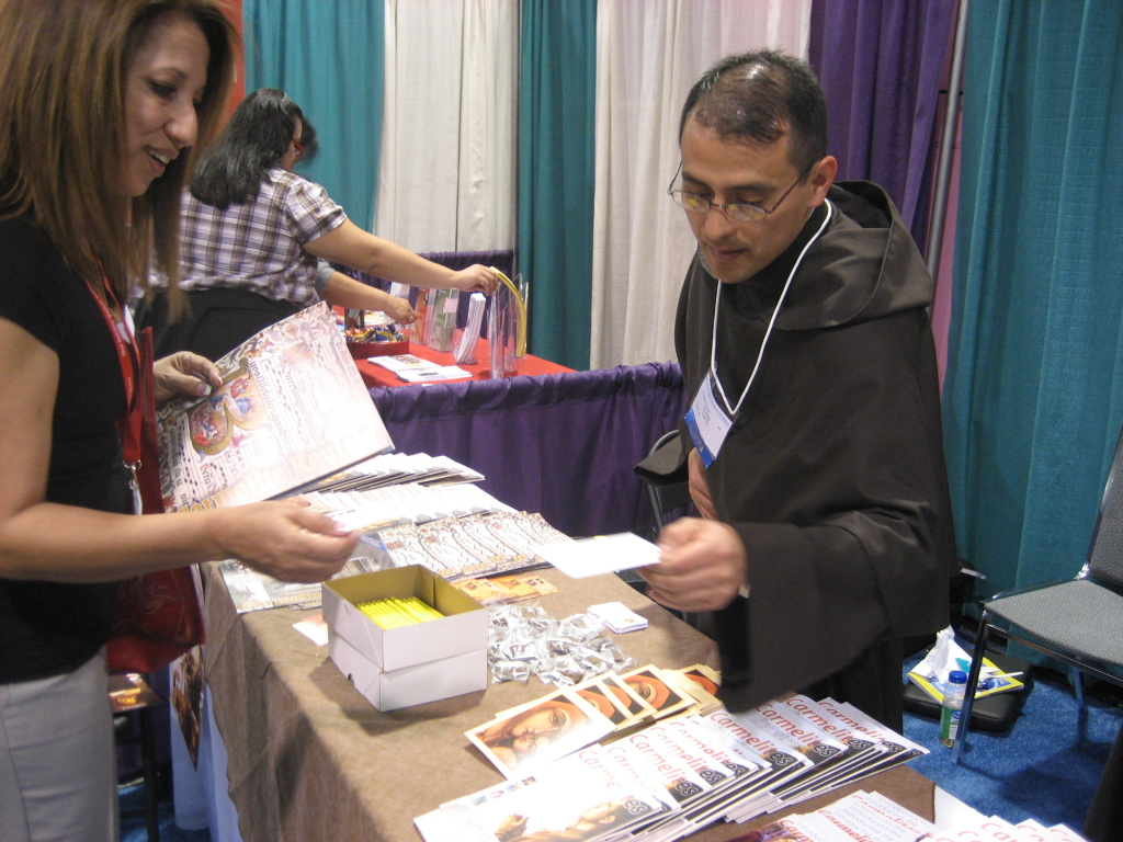 Carmelite Brother Edgar Enrique Lopez hands out information about his order at the recent Los Angeles Religious Education Congress in Anaheim.