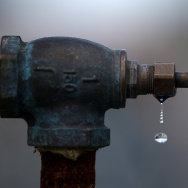 Water drips from a faucet at the Dublin San Ramon Services District (DSRSD) residential recycled water fill station on April 8, 2015 in Pleasanton, California.