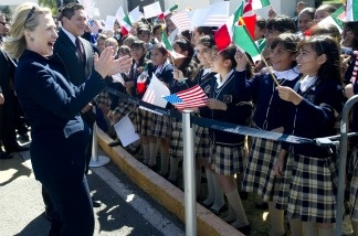 US Secretary of State Hillary Clinton greets Mexican school children upon arrival at Guanajuato International Airport in Guanajuato, Mexico, on Janu. 24, 2011. Clinton traveled to Mexico on a one-day trip for meetings with Mexican Foreign Minister Patricia Espinosa on border security and drug trafficking.