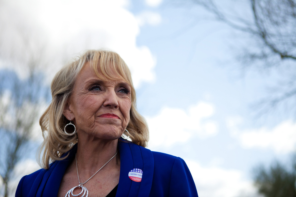 Arizona Gov. Jan Brewer talks to the news media after voting in the Republican presidential primary February 28, 2012 in Glendale, Arizona.