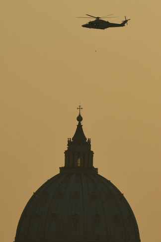 The helicopter with Pope Benedict XVI aboard flies over St Peter's basilica at the Vatican on February 28, 2013 in Rome. Pope Benedict XVI boarded a helicopter to fly to the papal summer residence of Castel Gandolfo outside Rome, where he will stay until his powers formally expire at 11:00 a.m. PST.