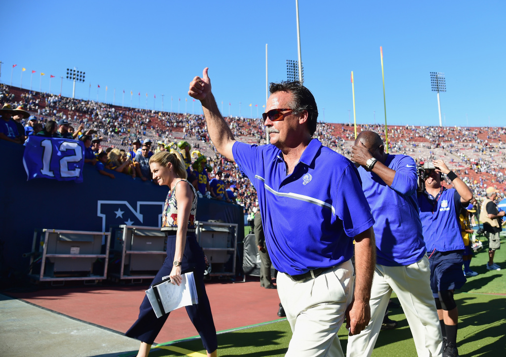 Head coach Jeff Fisher of the Los Angeles Rams celebrates as he leaves the field after his team's 9-3 victory over the Seattle Seahawks in the home opening NFL game at Los Angeles Coliseum on September 18, 2016 in Los Angeles, California.