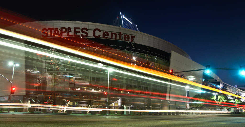 Vehicles pass by a darkened Staples Center on October 10, 2011.