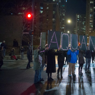 Demonstrators march through downtown following the release of a video showing Chicago Police officer Jason Van Dyke shooting and killing Laquan McDonald on November 24, 2015 in Chicago, Illinois.
