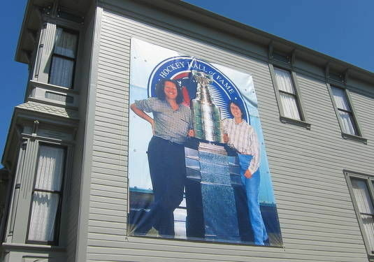 Aleta and Richard Collins have a 16x14-foot banner on their Angelino Heights home. The picture of them with the Stanley Cup was taken at the Hockey Hall of Fame 15 years ago. They're hoping to update the photo with a new one commemorating the L.A. King's Stanley Cup win.