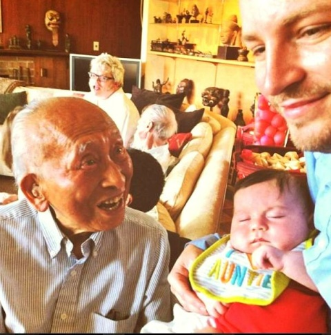 Artist Tyrus Wong, 102,  celebrating the hundredth day of a friend's baby, an important Chinese cultural custom.