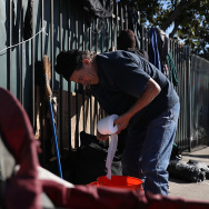 Rene Conant, a homeless man, packs up his camp on January 24, 2017 in Los Angeles, California.