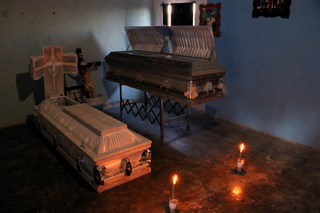 View of victims's coffins placed in a house after a military helicopter that fell on a van in Santiago Jamiltepec, Oaxaca, Mexico, on February 17, 2018.