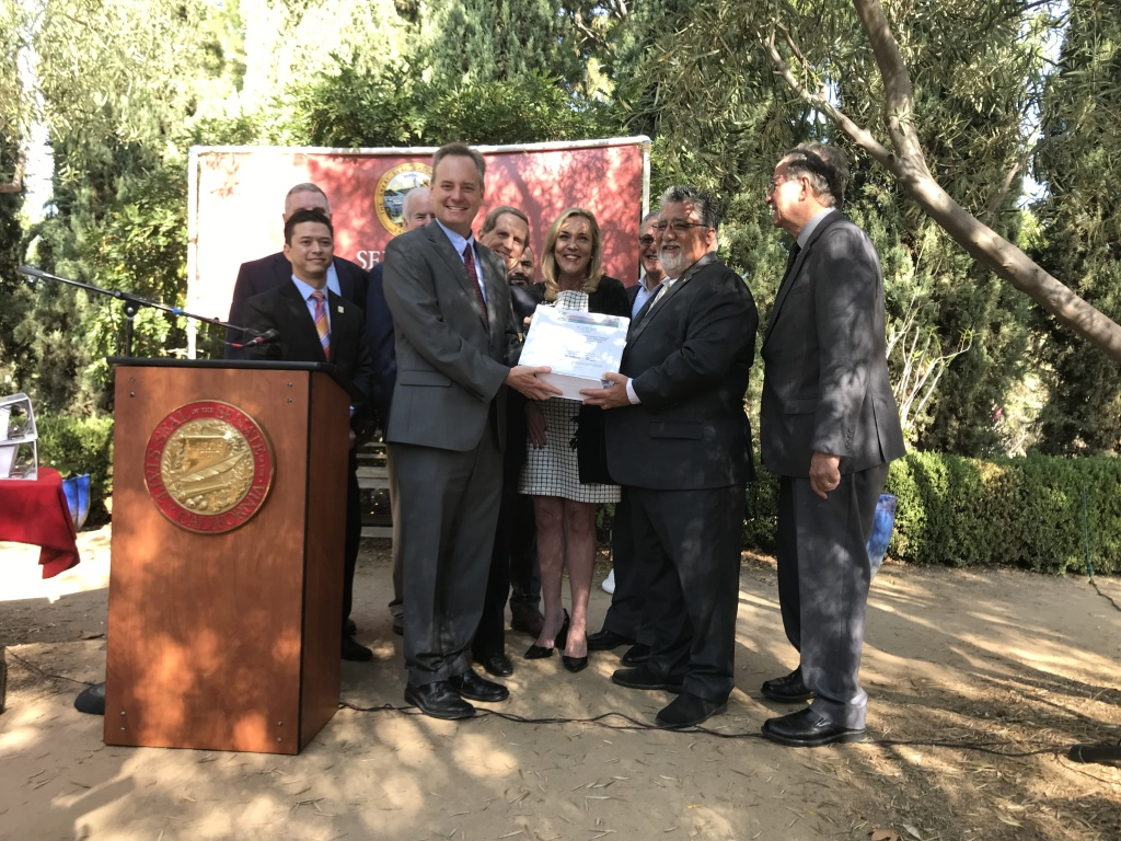 State Secretary of Transportation Brian Annis and State Senator Anthony Portantino hold part of the environmental impact report outlining the new plan for the 710 freeway improvement.