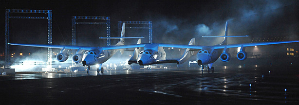 Virgin Galactic's SpaceShipTwo, the world's first commercial spacecraft for tourists, arrives slung under launch ship White Knight Two as it is unveiled at it's world debut, at the Mojave Air and Space Port in Mojave, California on December 7, 2009.
