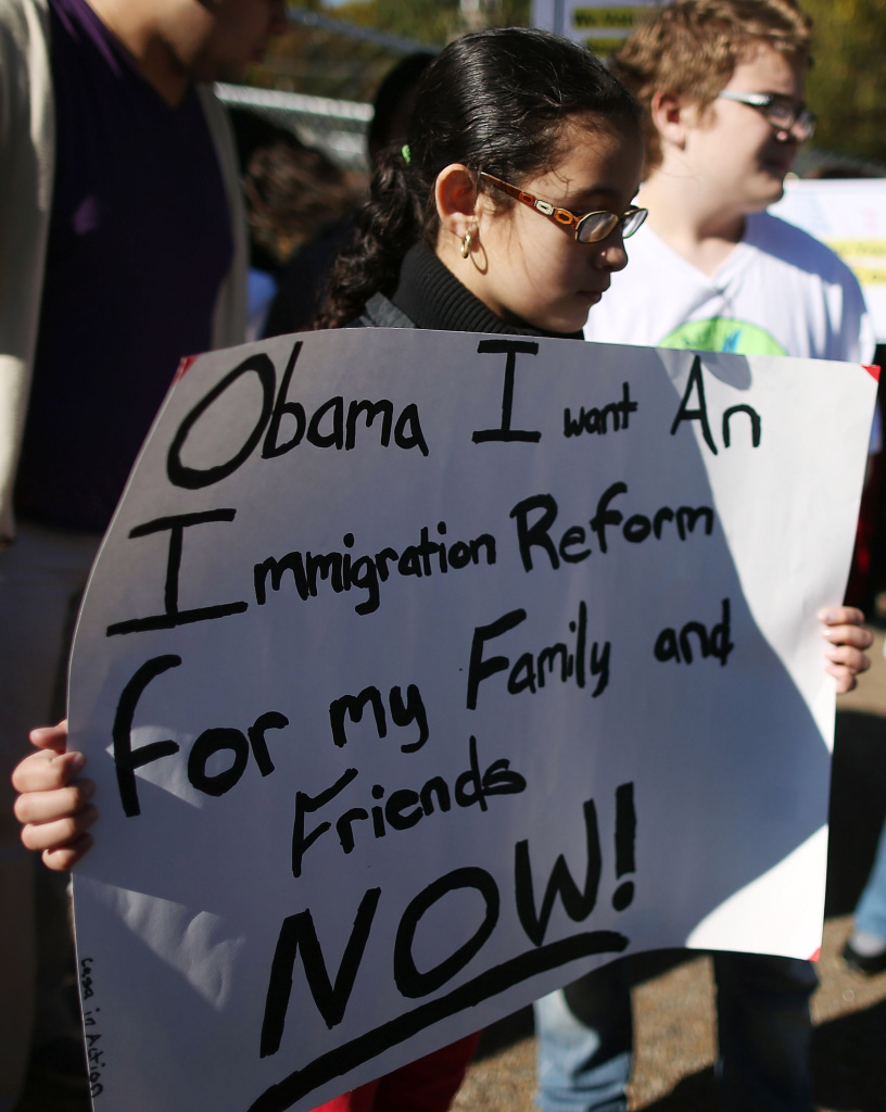 A girl holds a sign during an immigration rally in front of the White House on November 8, 2012 in Washington, DC. In a speech Thursday, President Obama called on lawmakers to act on immigration reform. So far there has been an impasse in Congress, with House Republicans promoting piecemeal measures but saying they will not support a sweeping proposal approved by the Senate in June.