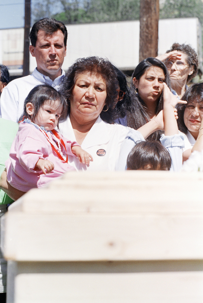 In this file photo, Helen Chavez holds grand daughter Christian, 1, while viewing he plain pine box containing her husband's body, Cesar, during graveside services at La Paz, the United Farm Worker's in Keene, California headquarter on Friday, May 1, 1993.