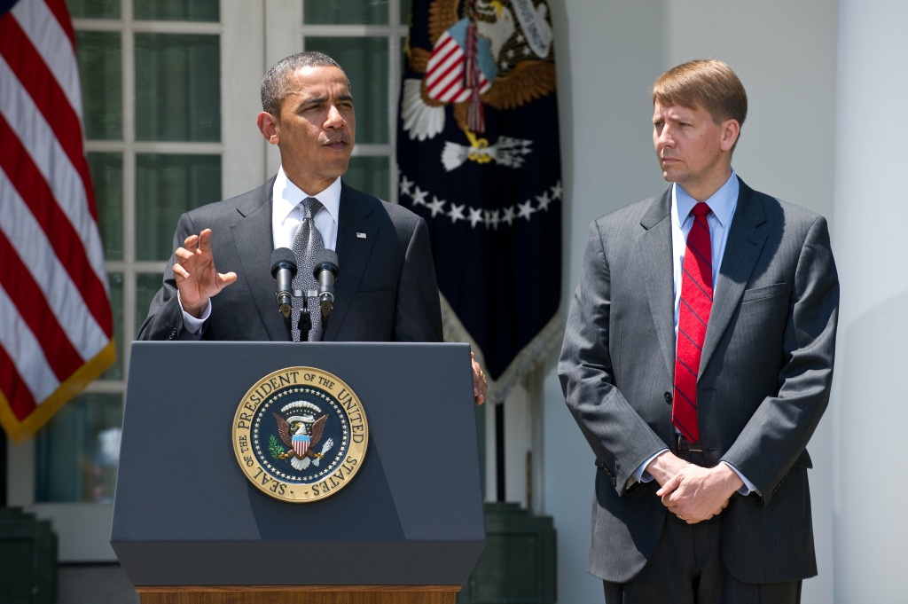 US President Barack Obama announces the nomination of Richard Cordray (R) to head the new Consumer Financial Protection Bureau in the Rose Garden at the White House on July 18, 2011 in Washington, DC.