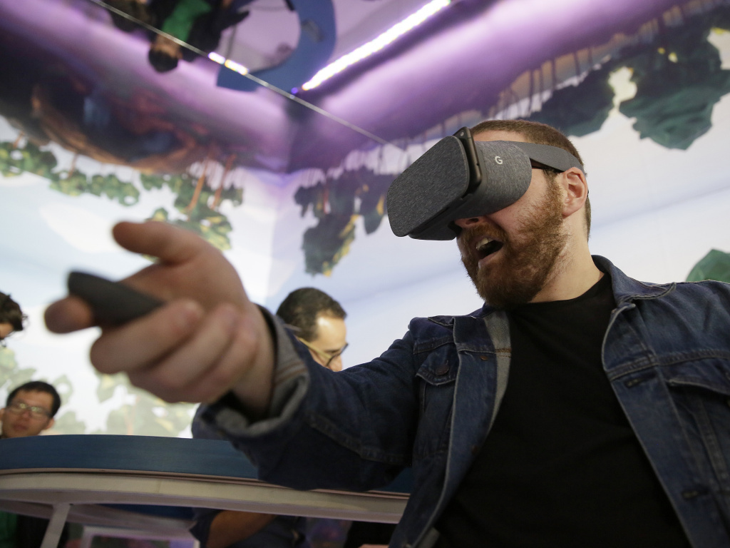 Dan Howley tries out the Google Daydream View virtual-reality headset and controller on Oct. 4, 2016, following a product event in San Francisco. This week, Google announced plans for stand-alone VR goggles that won't need to be attached to a PC or smartphone.