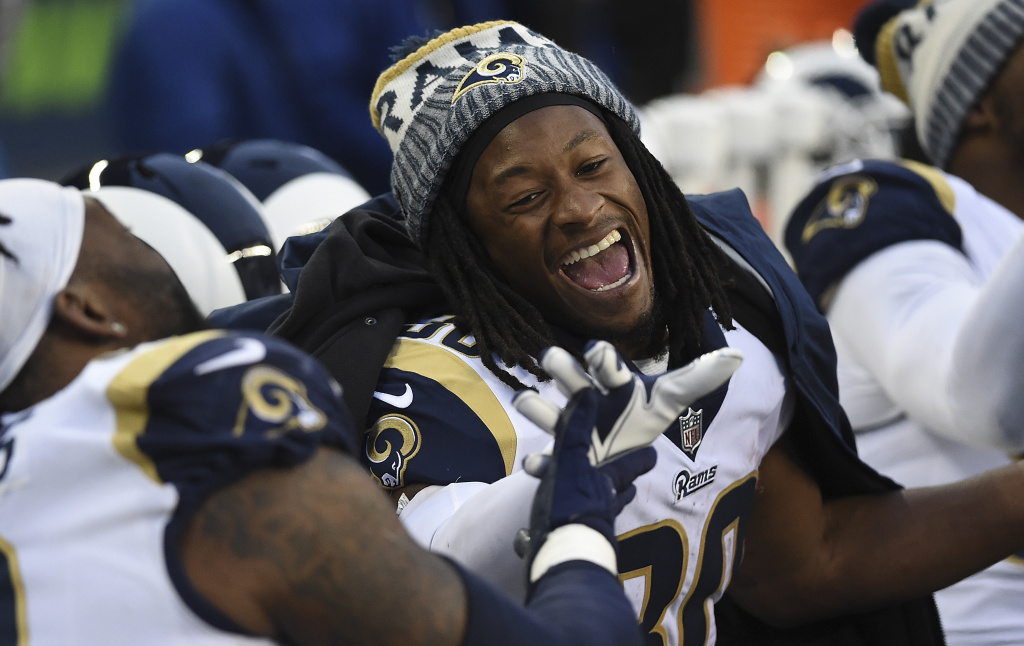 Running back Todd Gurley #30 of the Los Angeles Rams laughs on the sidelines during the fourth quarter of the game against the Seattle Seahawks at CenturyLink Field on December 17, 2017 in Seattle, Washington.