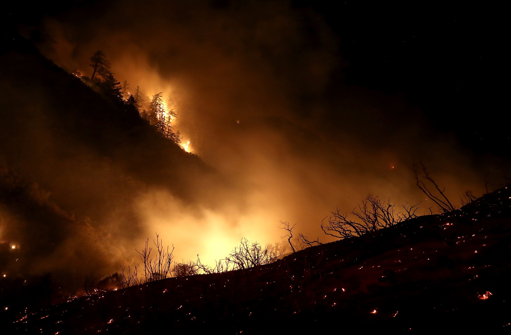 The Thomas Fire burns in the Los Padres National Forest on December 8, 2017 near Ojai, California.