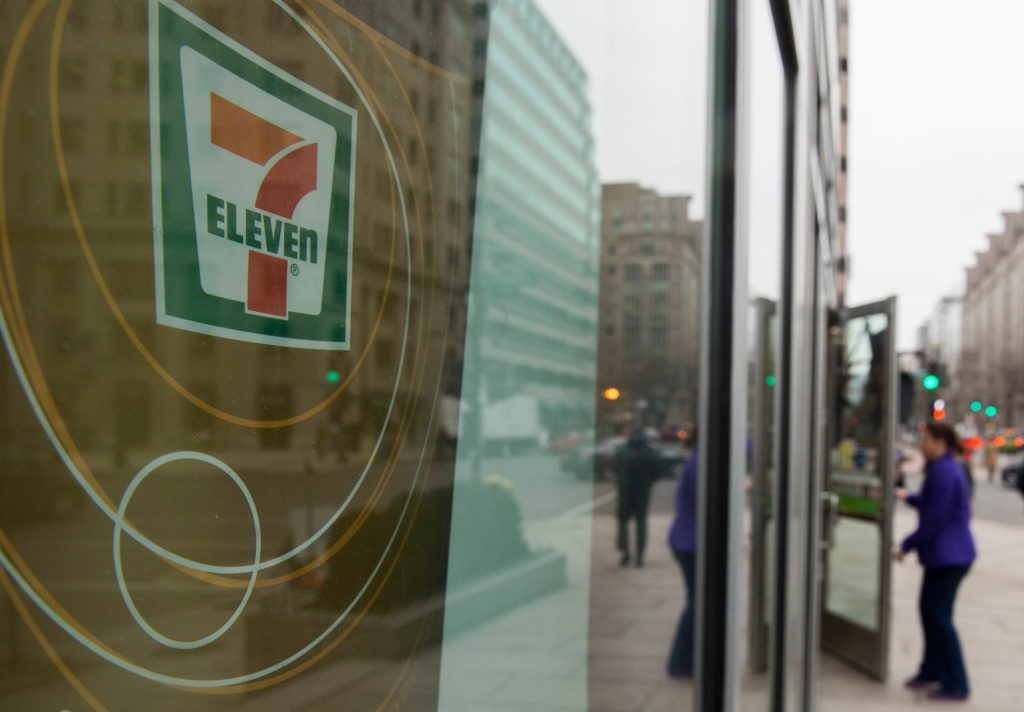 A woman walks into a 7-Eleven store in Washington, DC on January 10, 2018. US immigration agents raided nearly 100 7-Eleven convenience stores around the country, sending a warning to businesses not to hire illegal immigrants, officials said.