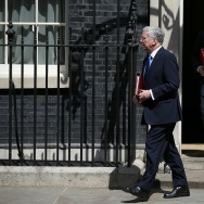 Britain's Defence Secretary Michael Fallon (L) and Britain's Foreign Secretary Boris Johnson leave Downing Street in central London. Britain's Prime Minister Theresa May said she would raise the issue of leaks from a probe into the Manchester terror attack that have infuriated British authorities with their US counterparts.