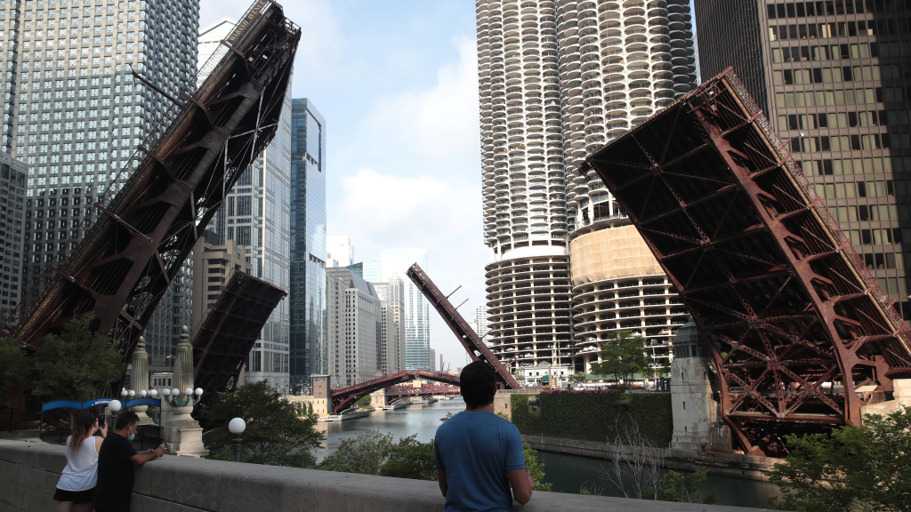 Bridges that lead into downtown Chicago were raised to limit access after looting and vandalism late Sunday and early Monday. Police made more than 100 arrests during the night of unrest and confiscated five guns.