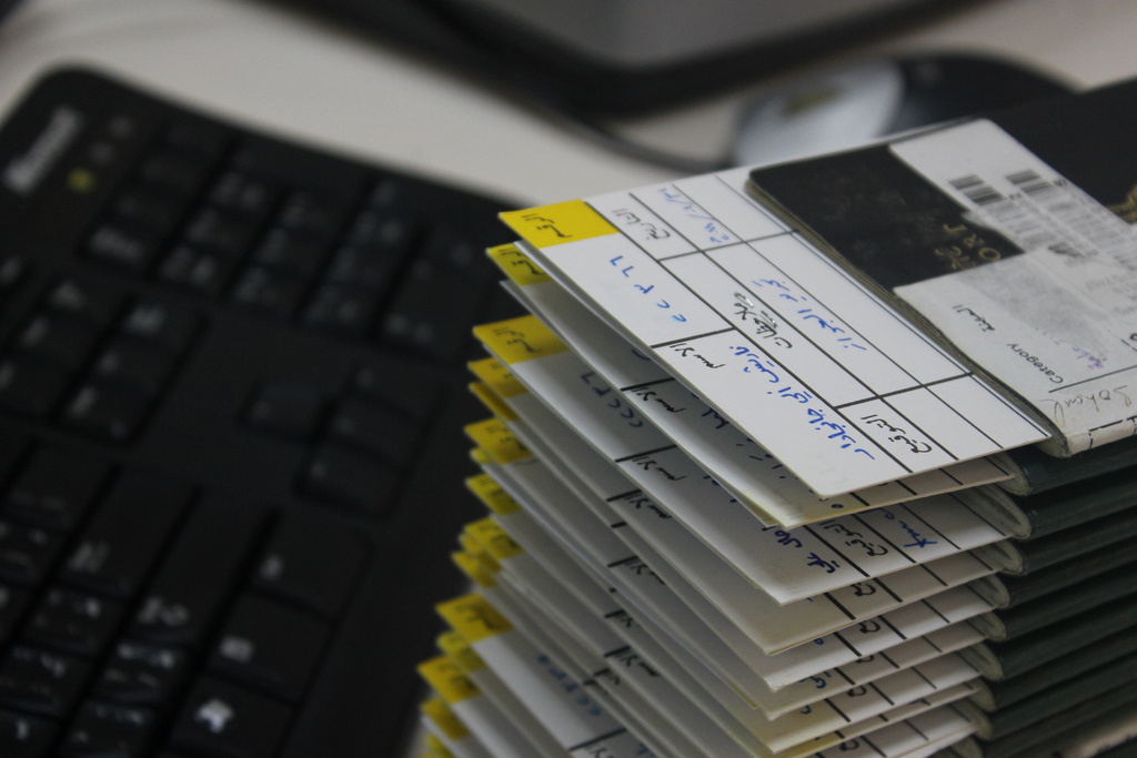 A stack of work visas await processing. A Canoga Park man who scammed businesses and immigrants looking for work visas will not serve any prison time.