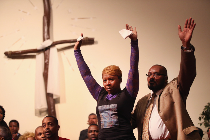 Lesley McSpadden (L), the mother of slain teenager Michael Brown joins a capacity crowd of guests at Greater St. Marks Family Church to discuss the killing of her son and the civil unrest resulting from his death on August 12, 2014 in St Louis, Missouri. Brown was shot and killed by a police officer on Saturday in the nearby suburb of Ferguson. Ferguson has experienced two days of violent protests since the killing but, tonight the town remained mostly peaceful.