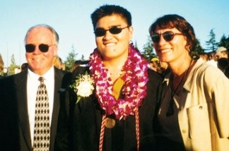 Jose Antonio Vargas (center) poses at his high school graduation with school officials Rich Fischer and Pat Hyland (right). The Pulitzer-winning journalist learned at age 16 that he was in the United States illegally.