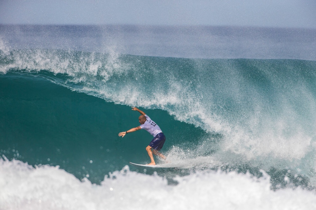 b0735e59f7 Kelly Slater pulls into the tube on  Backdoor  during the 1st round of the